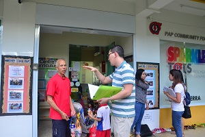 Volunteers engaging parents and children with survey questions